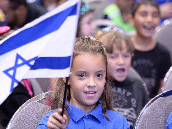 Ariela Nehemne Notification VBS student with Israeli flag