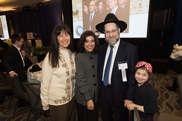 27th Awards Luncheon Milken Family Foundation Trustee Joni Milken-Noah visits with 2016 Jewish Educator Award recipient Rabbi Chaim Trainer and family.