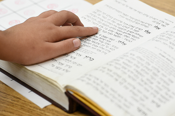 Rabbi Chaim Trainer Notification A student reads a Hebrew text at Yeshiva Rav Isacsohn in Los Angeles.