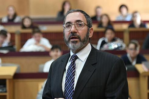 Jenny Zacuto Notification Yavneh Academy Headmaster Rabbi Moshe Dear opens the morning assembly.