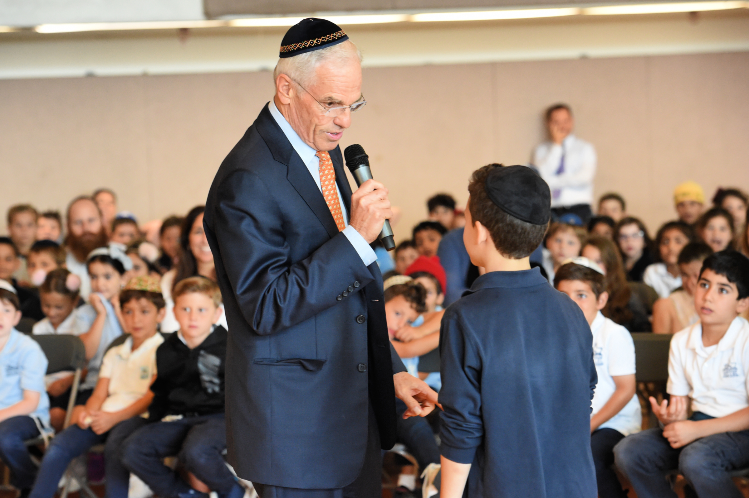 Florette Benhamou Notification Richard Sandler, executive vice president of the Milken Family Foundation, lets the students and staff in on a secret: One Harkham Hillel teacher is about to receive a very important award!